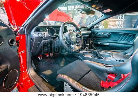 STUTTGART GERMANY - MARCH 17 2016: Cabin of pony car Ford Mustang GT fastback coupe (sixth generation) 2015. HDRi. Europe's greatest classic car exhibition