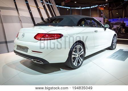 STUTTGART GERMANY - MARCH 17 2016: Compact executive car Mercedes-Benz C250 Cabriolet (W205) 2016. Rear view. Europe's greatest classic car exhibition