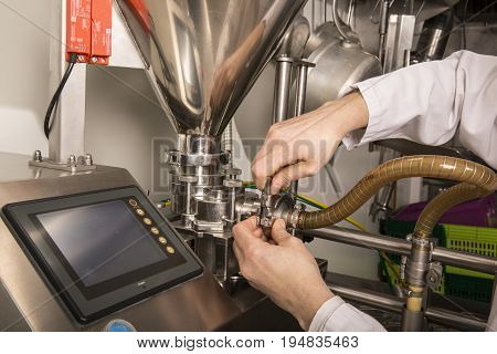 Woman hands the controls of a modern machine. Industrial machine regulations close up
