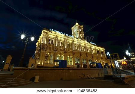 MOSCOW RUSSIA - MAY 22 2017: Facade historic building of the Leningradsky railway station (night) -- is one of the nine main railway stations of Moscow Russia
