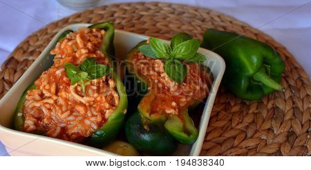 Green peppers stuffed with ground beef and rice. Summer gluten free food.