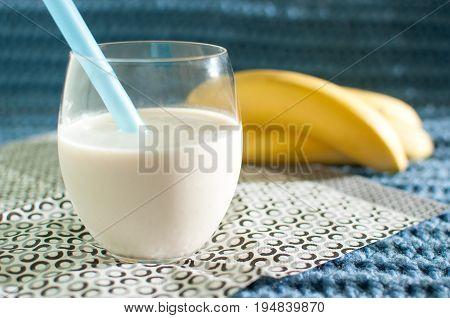 Healthy Food. Banana Smoothies. Milkshake And Ripe Bananas On Blue Fabric Background