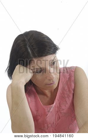 Woman with hand on forehead with white background