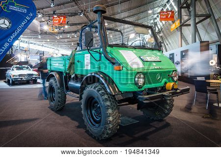 STUTTGART GERMANY - MARCH 18 2016: Multi-purpose auto four-wheel drive medium truck produced by Mercedes-Benz Unimog U600 1980. Europe's greatest classic car exhibition