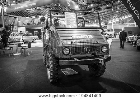 STUTTGART GERMANY - MARCH 18 2016: Multi-purpose auto four-wheel drive medium truck produced by Mercedes-Benz Unimog U25 1956. Black and white. Europe's greatest classic car exhibition