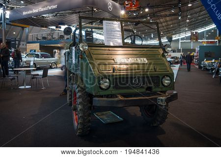 STUTTGART GERMANY - MARCH 18 2016: Multi-purpose auto four-wheel drive medium truck produced by Mercedes-Benz Unimog U25 1956. Europe's greatest classic car exhibition