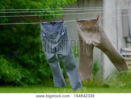 pants drying on a clothesline in the country