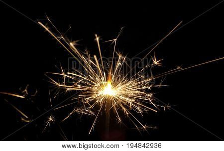 Close up fire spark with black background.