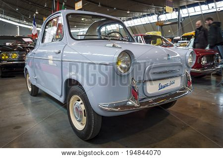 STUTTGART GERMANY - MARCH 18 2016: Microcar Vespa 400 produced by ACMA 1961. Europe's greatest classic car exhibition