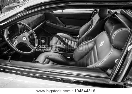 STUTTGART GERMANY - MARCH 18 2016: Cabin of sports car Ferrari F512 TR Testarossa 1993. Black and white. Europe's greatest classic car exhibition
