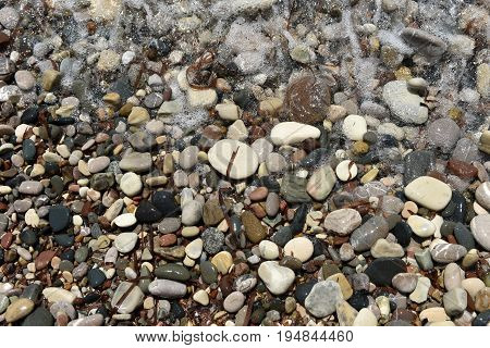 Sea Waves Approaching Pebble Stones