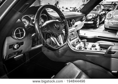 STUTTGART GERMANY - MARCH 18 2016: Cabin of supercar Mercedes-Benz SLS AMG 63 Coupe 2010. Black and white. Europe's greatest classic car exhibition