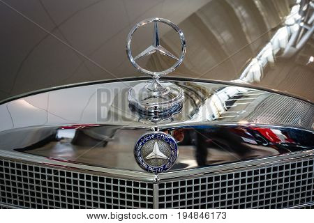 STUTTGART GERMANY - MARCH 18 2016: Hood ornament of Mercedes-Benz 220 SE (W128) close-up. Europe's greatest classic car exhibition