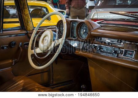 STUTTGART GERMANY - MARCH 18 2016: Cabin of full-size luxury car Mercedes-Benz 280 SE 3.5 Coupe (W111) 1970. Europe's greatest classic car exhibition