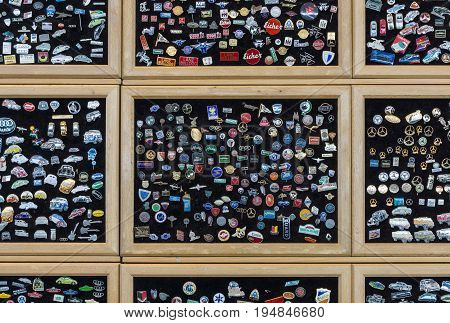 STUTTGART GERMANY - MARCH 18 2016: Background of lapel pins with the logos of well-known automobile firms (modern and retro). Europe's greatest classic car exhibition