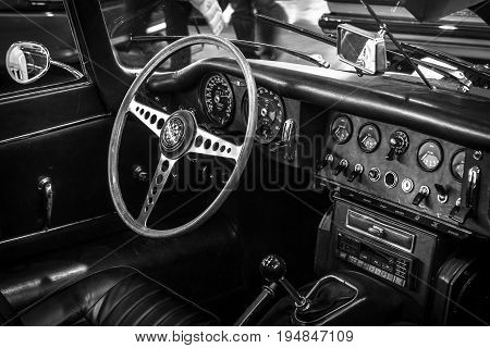 STUTTGART GERMANY - MARCH 18 2016: Cabin of sports car Jaguar E-Type 4.2 Serie I roadster 1967. Black and white. Europe's greatest classic car exhibition