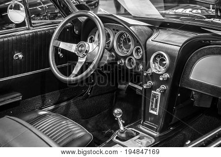 STUTTGART GERMANY - MARCH 18 2016: Cabin of sports car Chevrolet Corvette Roadster Black Old-School Resto Mod 1967. Black and white. Europe's greatest classic car exhibition