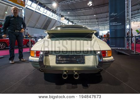 STUTTGART GERMANY - MARCH 18 2016: World premiere of Restomod Porsche 911and 933 equipments by Kaege Retro 2016. Rear view. Europe's greatest classic car exhibition