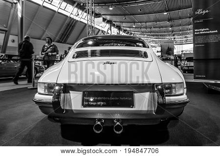 STUTTGART GERMANY - MARCH 18 2016: World premiere of Restomod Porsche 911and 933 equipments by Kaege Retro 2016. Rear view. Black and white. Europe's greatest classic car exhibition