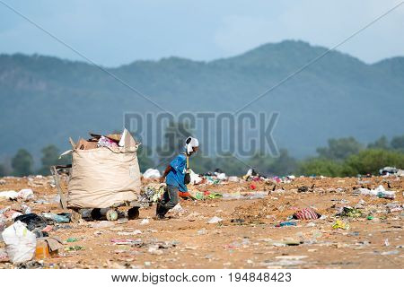 Kota Kinabalu, Malaysia - 09 July, 2017: A Man Pulling A Big Basket Full Of Reusable And Recyclable