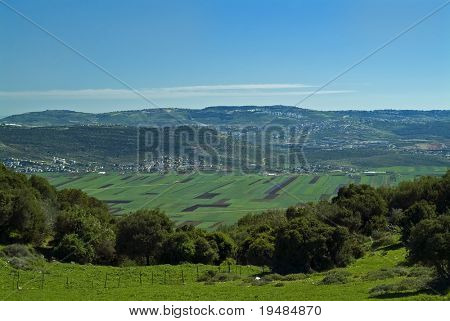 view of Beit Netofa valley in the Galilee, Israel, with Nazaret on the horizon