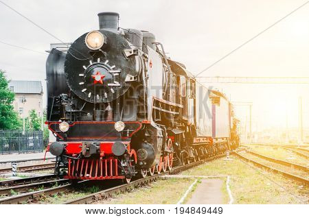 Vintage Blacksteam Locomotive Train Rush Railway Station. Concept Of Tourism Is A Retro Journey By T