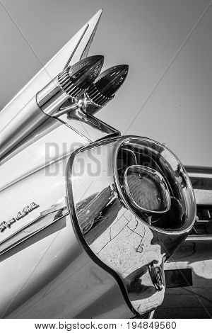 STUTTGART GERMANY - MARCH 18 2016: Detail of the rear wing and brake lights of the car Cadillac Coupe de Ville Black and white. Europe's greatest classic car exhibition
