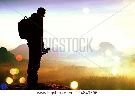 Film Grain. Silhouette Of Photographer Overlooking A Blanket Of Fog Over Valley To Sun