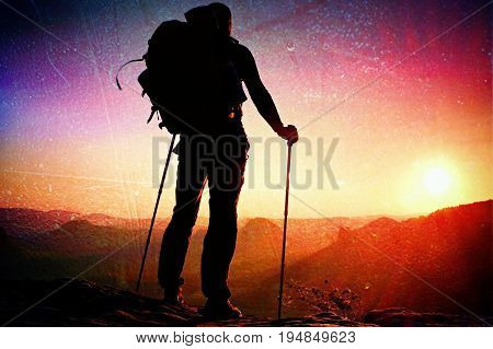 Film Grain. Tall Backpacker With Poles In Hand. Sunny Spring Daybreak In Rocky Mountains. Hiker With