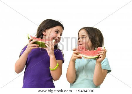 Two girls eating Watermelon isolated on white background