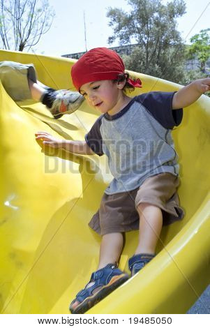 boy on a yellow playground slide
