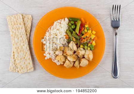 Fried Meat With Rice And Vegetables On Plate, Crispbread