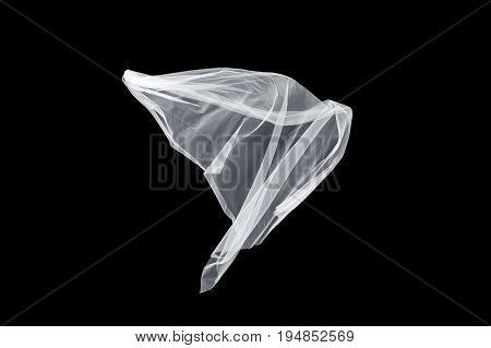 wedding white Bridal veil isolated on the black background. veil flutters in the wind