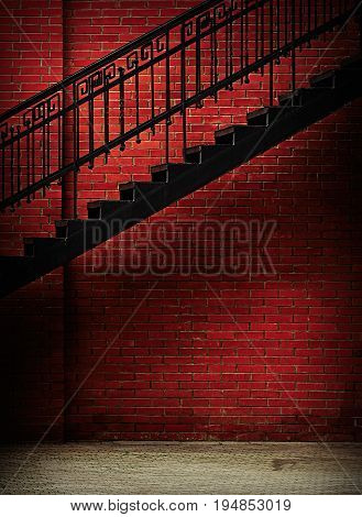 Iron metal stairway with grunge red brick wall background