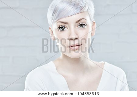 Closeup portrait of trendy young platinum blonde woman.