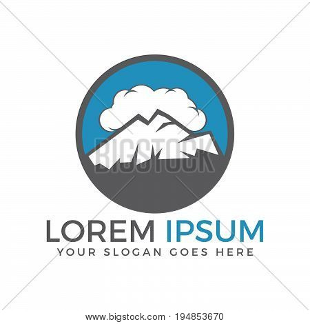 High mountain peaks in a cloud sky logo design. Mountain landscape in round logo.