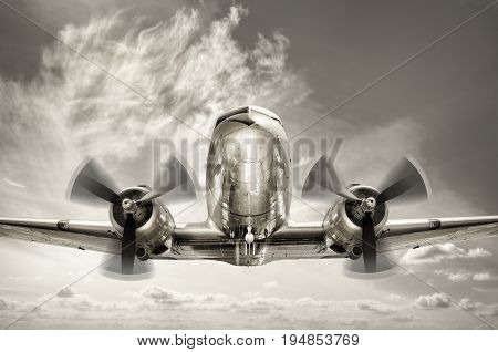 an old aircraft over the clouds in the sky