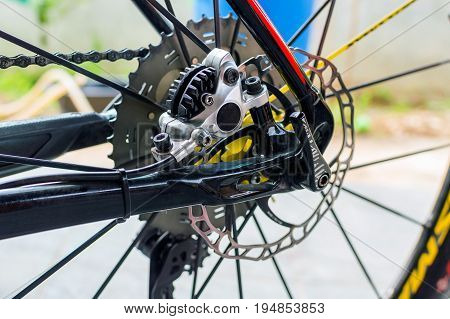 Bicycle hydraulic rear disk brake. Bicycle gears disc brake and rear derailleurbike parts chain wheel frame.