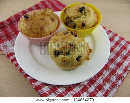 Fresh baked spelt muffins with dried grapes