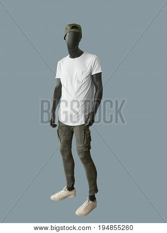 Full-length man mannequin dressed in summer casual clothes isolated. No brand names or copyright objects.