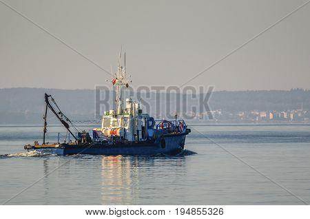 DREDGER - Small ship on the Pomeranian Bay