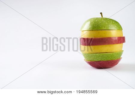 Fresh three apples. Sliced colorful apples isolated on white background with copy space. Vegetarian food. Healthy and detox concept.
