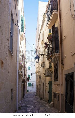 Monopoli, Puglia, Italy - beautiful sunny alley with lanterns