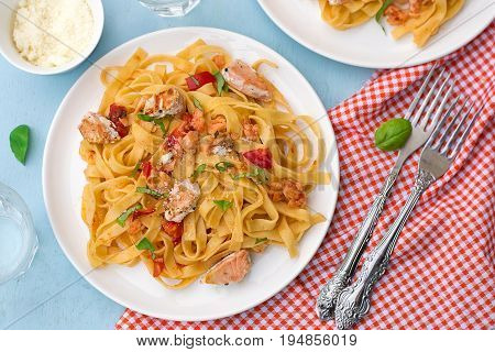 Pasta Tagliatelle with salmon fish tomatoes and basil