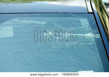 Smashed front window of the car. Destroyed. Damaged. Crashed. Car crash. Glass damage.