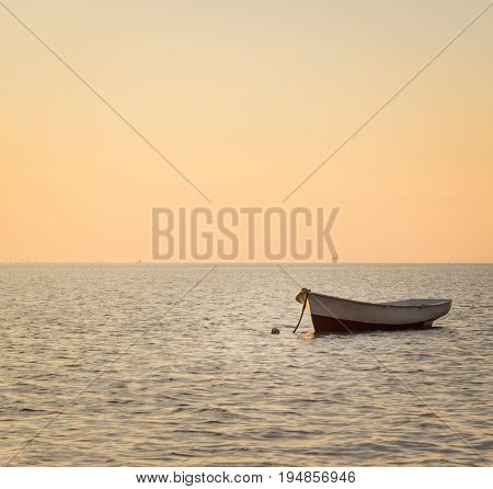 Boat sea and beautiful evening sky warm colors and no one