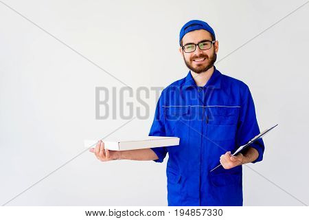 Pizza delivery service concept: delivery guy bringing pizza box