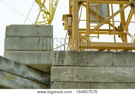 Construction crane concrete blocks in the foothill on the construction site. Close up.