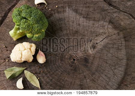 Assortment of cabbages broccoli and cauliflower on old wooden background with copy space. Helathy vegetarian food and detox concept.