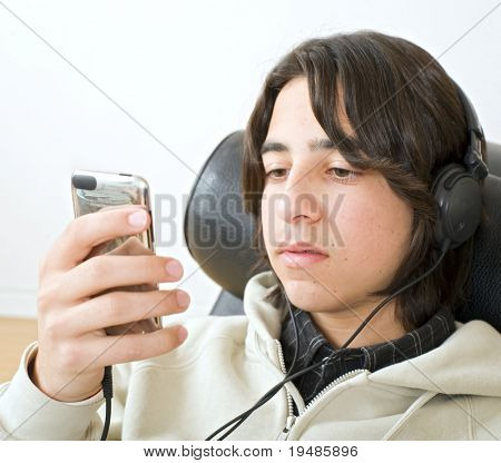 teenager  listening to music with headphones